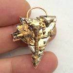 Bismuth gold sharktooth pendant.