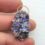 Bismuth oval cabochon pendant.